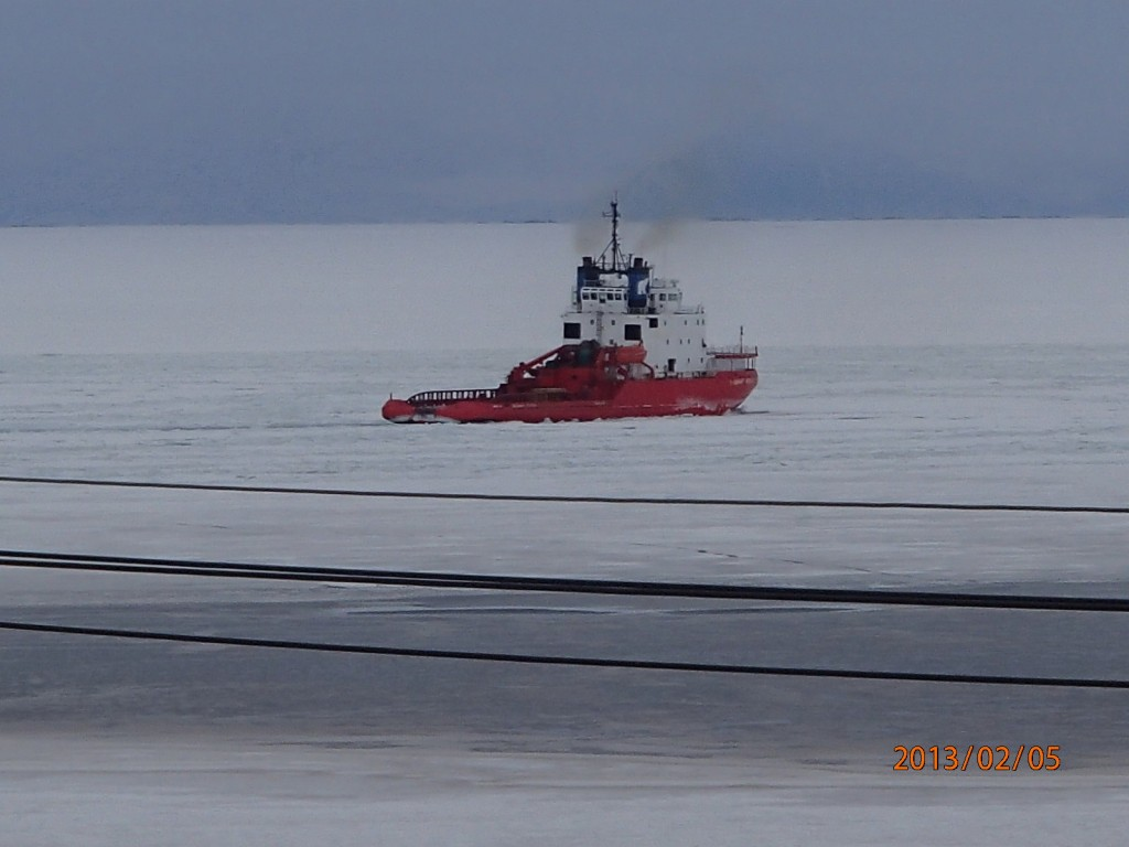 Russian Icebreaker cutting a path for the fuel ship