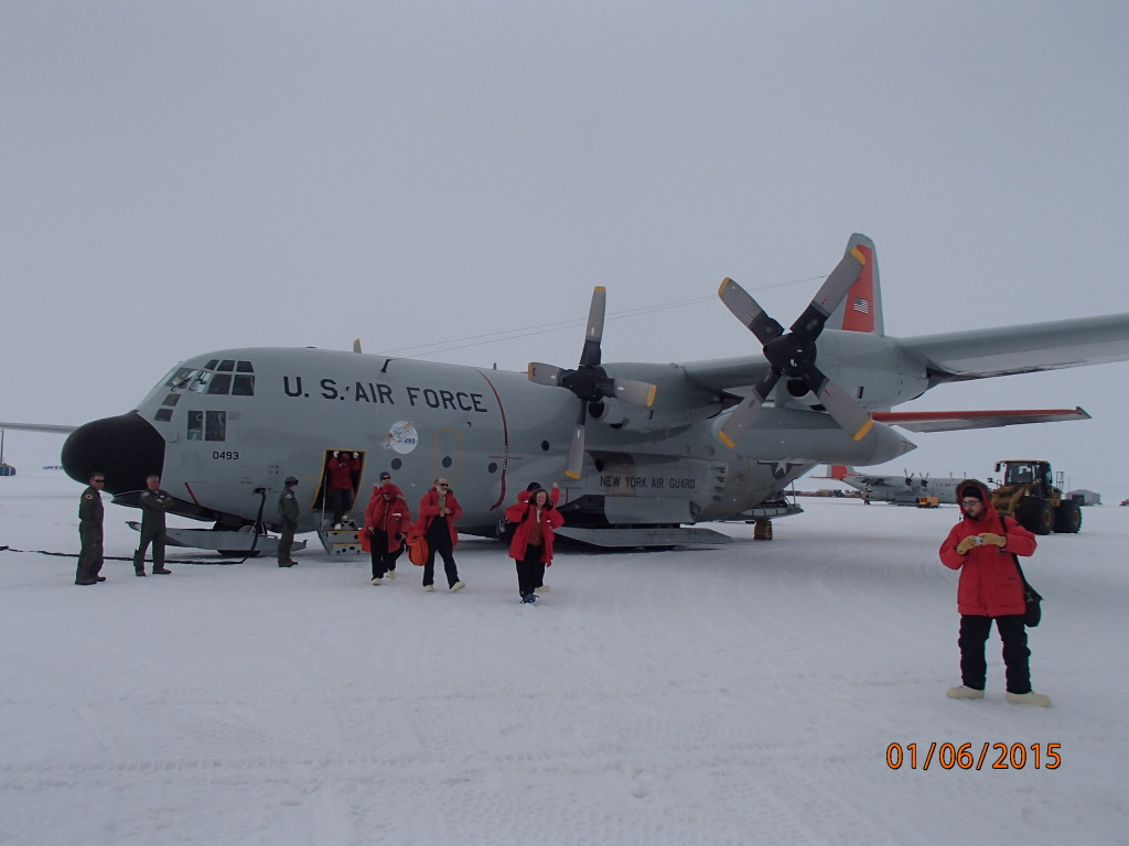 The C-130 Cargo plane lands on skis on a glacier on Ross Island in Antarctica