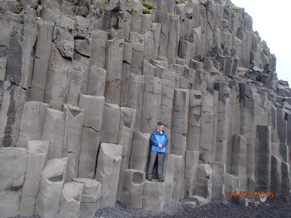 Basalt columns from ancient volcanoes at the beach in Iceland