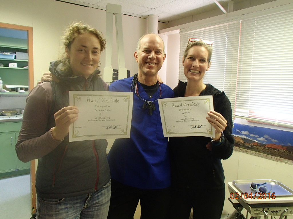 Catherine and Lynn holding their dental certificates
