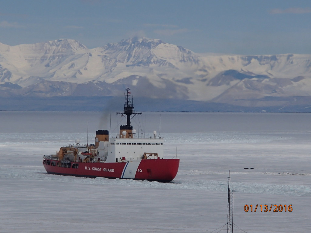 The US Coast Guard icebreaker opens a path for the cargo ship