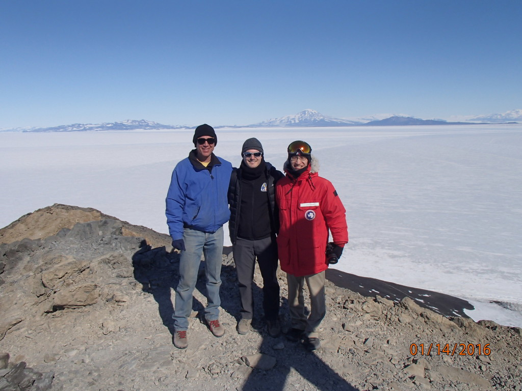 Rob and Andy join me on our first hike up Observation Hill  looking out over the frozen Ross Sea