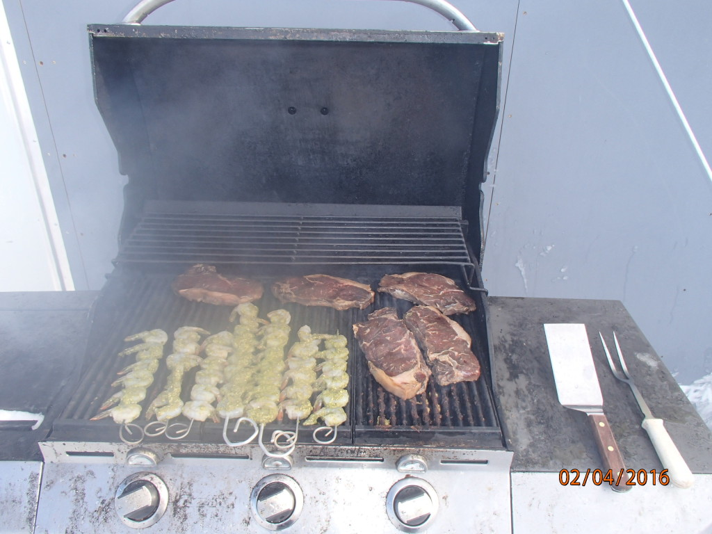 Grilling shrimp and steak for lunch on the ice shelf