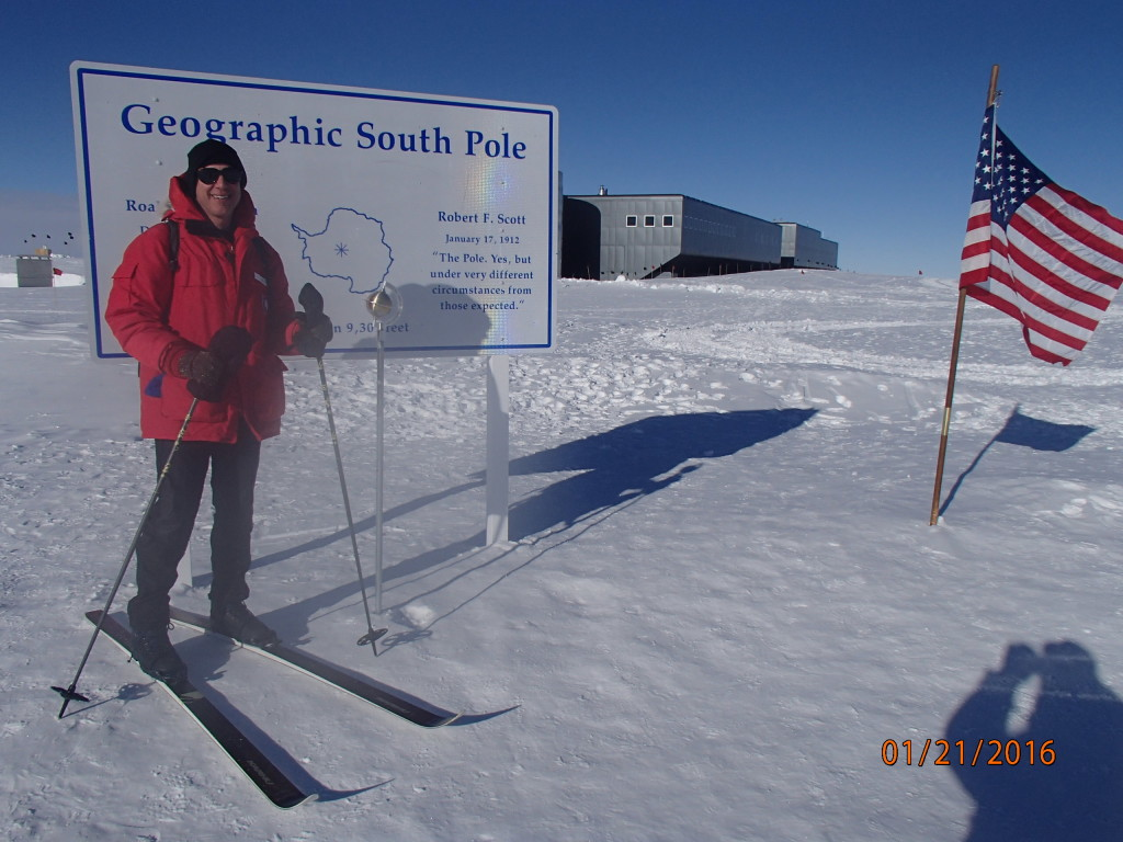 Skiing outside the South Pole station to the geographic pole marker